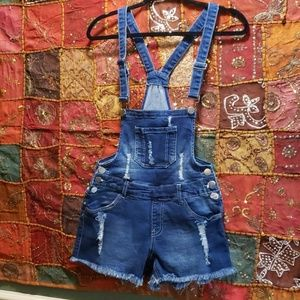 Distressed overalls with stretch